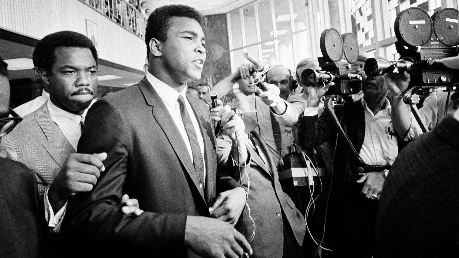 """Heavyweight boxing champion Muhammad Ali said, """"No comment"""" when confronted by the media as he left the Federal Building in Houston during his trial for refusing induction into the U.S. Army in 1967. Ed Kolenovsky/AP Photo"""