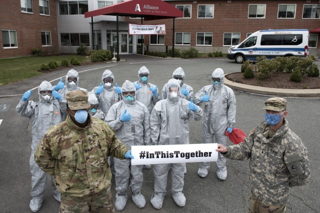 Soldiers and Airmen from the Massachusetts National Guard gather together prior to completing COVID-19 testing on residents at the Alliance at West Acres nursing home, Brockton, Mass., April 10, 2020. Twelve medical teams are activated throughout the state and are conducting COVID-19 testing at medical facilities and nursing homes with high-risk populations. Homes and providers are identified by the Department of Public Health and Human Services for testing. This mission is one of several operations across the commonwealth in support of coronavirus response efforts. (Capt. Bonnie Blakely)