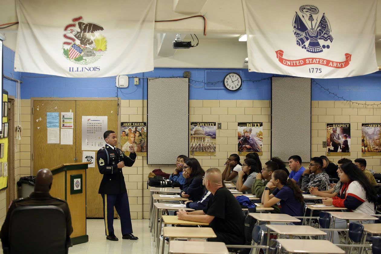 Sgt. 1st Class Jose Tejada speaks to a class of Junior ROTC students about what life is like in the U.S. Army for new recruits. PHOTO: JOSHUA LOTT FOR THE WALL STREET JOURNAL