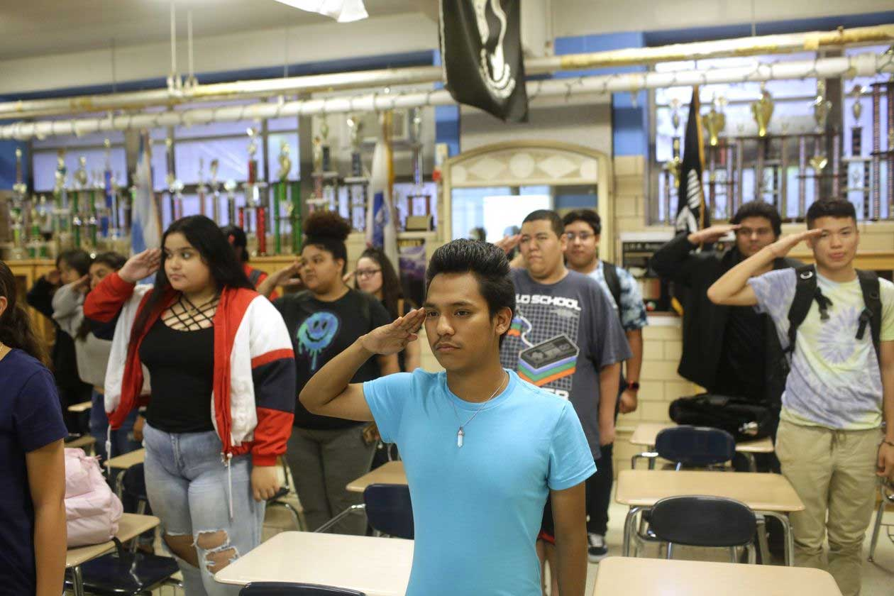 IMAGE 2 JROTC Students at a Chicago school saluted during a meeting where Sgt. Tejada spoke. PHOTO: JOSHUA LOTT FOR THE WALL STREET JOURNAL