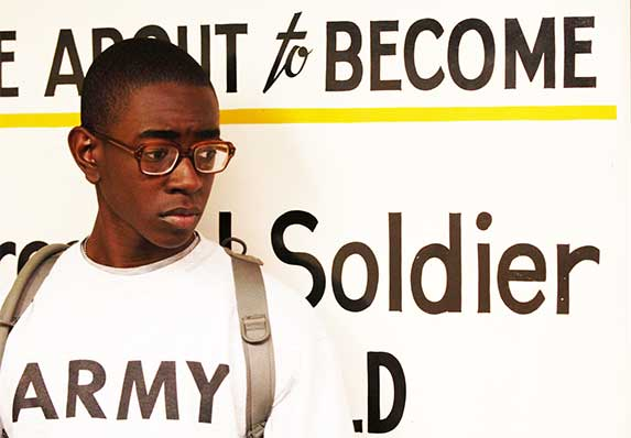 U.S. Army Private Reginal Johnson waited in line to be issued his uniform during basic combat training at Fort Jackson, South Carolina, in 2008. South Carolina is among the Southern states that provide a disproportionate number of new military recruits compared to its young adult population. (U.S. Air Force photo by Staff Sgt. Manuel J. Martinez via Flickr.)