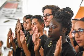 Future Soldiers from the Miami Recruiting Battalion take the oath of enlistment during the Air and Sea Show in Miami Beach, Florida. (U.S. Army photo by Lara Poirrier) (Photo by Lara Poirrier)